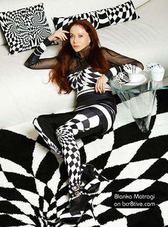 Blanka Matragi poses with her Porcelain, Rugs & Pillows on bcr8tive.com
