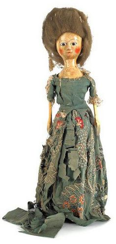 antiques price guide, antiques priceguide, dolls, England, An English Queen Anne wooden doll, [having a painted face] with brown glass eyes and original hair and silk embroidered dress.