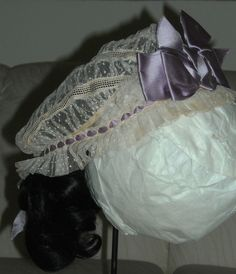Stunning Civil War Era Headdress 1860s Sheer Dotted Net Indoor Bonnet Silk Bows | eBay seller vintagecloset1800; fine dotted net with rows of cording between it, decorated with lavender silk ribbon bows; head opening: 20""