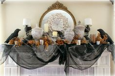 Crows, old book pages, and a healthy dose of black gauze up the spooky factor of this elegant fireplace by Kimberlee at The Fancy Shack. See more at The Fancy Shack.