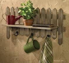 Picket fence decor by adding a shelf for more ideas on decorating for the seasons and holidays!