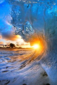 Mother Nature is clearly good with water colours.  These amazing pictures taken on a beach in Hawaii capture the exact moment the wave breaks, revealing a stunning kaleidoscope of hues.  The Pacif