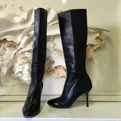 Jimmy choo black boot with elastic back Never worn outside. Butter soft leather with stretch fabric in back, very fitted. Size 35. Make in Italy. Jimmy Choo Shoes Heeled Boots