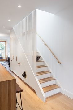 Staircase, Wood Tread, and Wood Railing CAB Architects deftly hid appliances, pantry storage, and a litter box for the owners' two cats in the cabinetry beneath this staircase in Ritchie Rowhouse. Home Stairs Design, Interior Stairs, Modern House Design, Home Interior Design, Staircase Storage, Stair Storage, Pantry Storage, Box Bedroom, Edwardian House