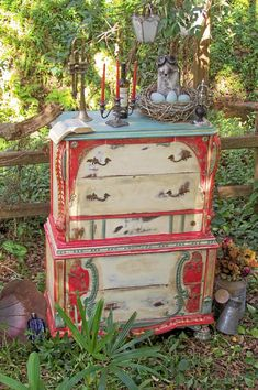 Dishfunctional Designs: Upcycled Dressers: Painted, Wallpapered, & Decoupaged Love that dresser it reminds me of a traveling circus!