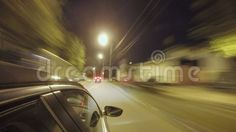 Driving at high speed through the night city street. Blurred timelapse with view from outside of the cabin.