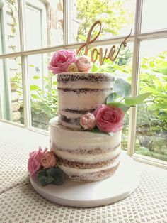 Semi-naked wedding cake with fresh roses