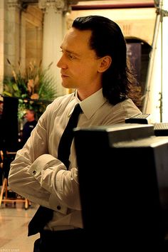 This is either a behind-the-scenes shot of Tom, or it's Loki waiting for his bloodstained suit jacket at the drycleaners.