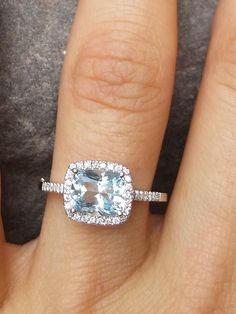 14K Aquamarine & Diamond Halo Ring - I really like the halo design, and a different gemstone in the center is unique