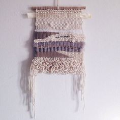 Handwoven wall hanging made with all natural fibers and using a variety of weaving techniques to create this unique piece for your walls. Materials: Wool, cotton, driftwood, pearl wood Dimensions : 23cmx30cm (without fringes graves on the sides) Handwoven by Juffie Every piece is