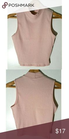 Ribbed Pink Crop Top,  NWOT. Ribbed Pink Crop top,  New without tags!  No flaws.  Offers welcomed through offer feature, Bundle and save  :) Charlotte Russe Tops Crop Tops