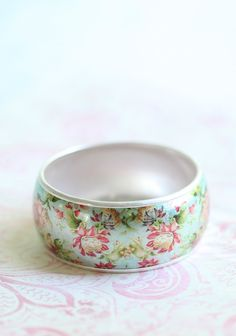 """A Dream Within Floral Bangle 12.99 at shopruche.com. This silver hued bangle is perfected with a shimmering floral print.  Approx. 2.5"""" diameter, Approx. 1.25"""" wide"""