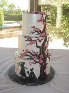Japanese cherry blossom tree and warrior tiered wedding cake.