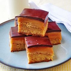 Millionaire Blondies - a blondie cookie bar base with a thick caramel center and a chocolate finish.
