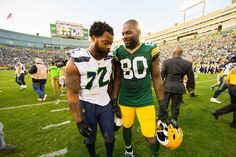 Brothers: Seattle Seahawks defensive end Michael Bennett (72) and his brother Green Bay Packers tight end Martellus Bennett (80) talk following a NFL football game during week 1 on Sunday, September 10, 2016 at Lambeau Field in Green Bay. The Packers beat the Seahawks 17-9.