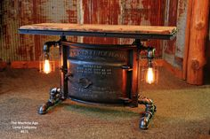 Industrial table, antique iron boiler door and old barn wood. Steampunk, pipe iron