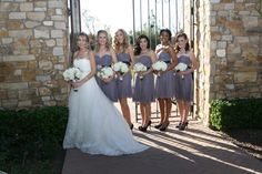 Grey bridesmaid dresses with white bouquets and black heels | villasiena.cc