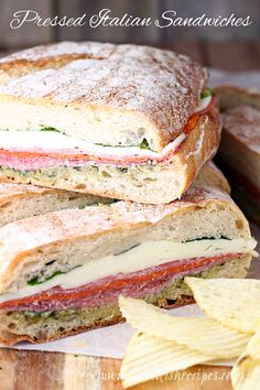 Pressed Italian Sandwiches: Italian meats and cheeses are layered with pesto and fresh basil, then wrapped and pressed in these flavorful sandwiches that are perfect for picnics and parties. recipes for two recipes fry recipes Gourmet Sandwiches, Italian Sandwiches, Cold Sandwiches, Panini Sandwiches, Reuben Sandwich, Soup And Sandwich, Best Sandwich Recipes, Italian Panini, Chicken Sandwich