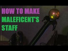 Maleficent staff from gift wrap tube, ball, paint, and tape.