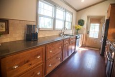 Red River Remodelers- galley kitchen.  cork floors.  Wood stain cabinets