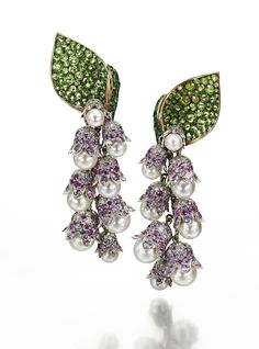 Lily of the Valley Earrings in yellow and white gold, set with 18 Akoya pearls, 544 purple sapphires, 152 green garnets, 330 diamonds and 36 emeralds, by Suzanne Syz.