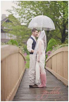 Rainy wedding day shot on the bridge to no where at Chetola Resort....so beautiful!