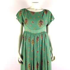 """Floral Voile Loose Babydoll Formal Maxi Dress Beautiful antique style semi-formal voile dress in muted mint green w/ floral pattern in pink, green, yellow, brown, & off-white. F/ soft pleats at empire waist, full skirt, large overlay collar, flutter sleeves, & light green underskirt. Bodice is unlined. Great condition. Probably a custom bridesmaid or #prom dress. No size tag - fits a 4-6. Pull-over style w/ no zipper/buttons so the 32"""" waist has to fit over your bust to put it on. Pit to…"""