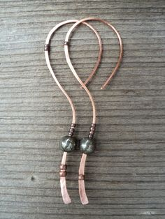 Copper and pyrite natural abstract hoop earrings with long tail. Long hammered asymmetrical one-piece copper earrings for women and teens.