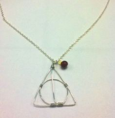 DIY deathly hallows necklace. There are so many jewelry things one could make with the proper wire!