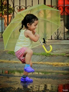 Playing in the rain, I should do this often even at 65 Umbrella Art, Under My Umbrella, Walking In The Rain, Singing In The Rain, Precious Children, Beautiful Children, Rain Days, Weather Rain, I Love Rain