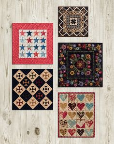 How do you display mini quilts? Make a mini-quilt gallery! Get layout dimensions for this gallery and see the mini-quilt gallery we've started in our office sewing studio.