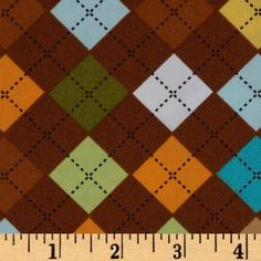 Remix Argyle Chocolate from @fabricdotcom  Designed by Ann Kelle for Robert Kaufman Fabrics, this cotton print fabric is perfect for quilt or craft projects, apparel and home decor accents. Colors include yellow, orange, olive, turquoise, aqua and white on a brown background.