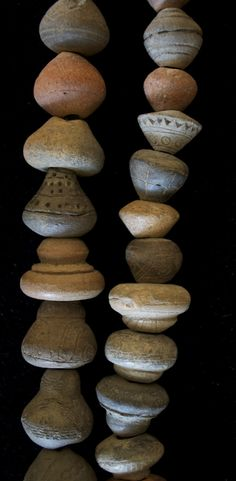 Ceramic spindle whorls. Whorl = a small wheel or pulley in a spinning wheel, spinning machine or spindle.