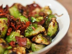 I like to challenge myself to cook almost any recipe on the grill. So when I finally got around to making Kenji's brussels sprouts with bacon I've been lusting after for a year now, I thought I'd see what I could do over the flames.