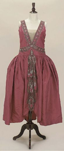 A RARE ROBE DE STYLE, JEANNE LANVIN  of deep rose pink silk, embellished with swathes of silver and white beadwork to bodice and skirt, unlabelled, circa 1924