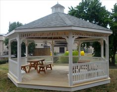 Eye Catching Wooden Gazebo With Picnic Tables On Wooden Floor Kit Design