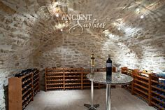 Pictures of Antique limestone floors and stone wall cladding veneer inside wine cellars by Ancient Surfaces/ www.AncientSurfaces.com