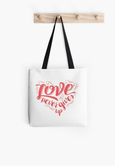 """Buy """"Love Never Gives Up"""" Tote Bags #redbubble #quotes #totebags #sayings #motivation"""