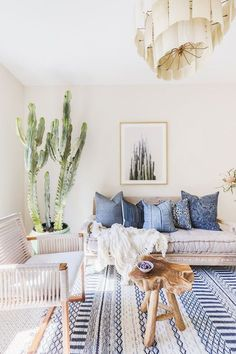 This desert-inspired living room features calming blue textiles and chic wood furniture