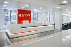 Interior,Modern Aegis London Insurance Office Interior Design Ideas With Sleek White Receptionist Desk And Orange Accent,Modern Insurance Office Interior Design Ideas