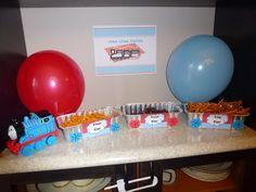 "Coal car (mini oreos), Log car (pretzel sticks), Fish car (goldfish crackers) at the ""chew chew station"""