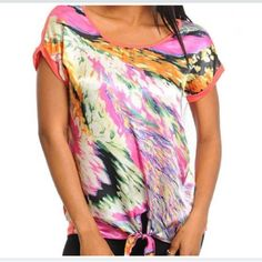 Adorable brightly printed silky blouse with the bottom and stretchy back - new with tags