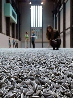 """Sunflower Seeds by Ai Weiwei: More than 100 million individually made porcelain """"sunflowers"""" have been spread across the east end of the Turbine Hall at the Tate Modern for visitors to touch, walk on and listen to. where is ai wei wei? Ai Weiwei, Land Art, Art Conceptual, Turbine Hall, The Farm, Instalation Art, Art Chinois, Wei Wei, 3d Fantasy"""