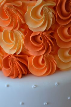 Orange ombre Blossom Cake created by Bake Sale. Candy Table styling by Sweet Dessert Table.