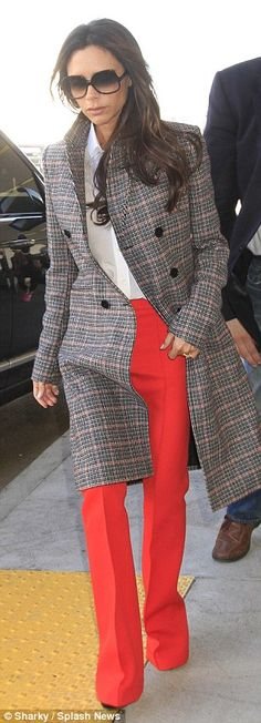 Preppy touch: The fashion designer donned a preppy plaid coat over her head-turning attire...
