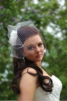 half up wedding hair with birdcage veil