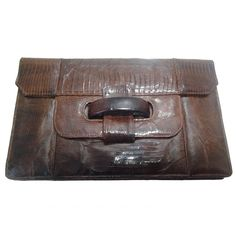 1940s Argentinian Chocolate Brown Lizard Clutch w/ Slide Tab Closure | From a collection of rare vintage clutches at https://www.1stdibs.com/fashion/handbags-purses-bags/clutches/