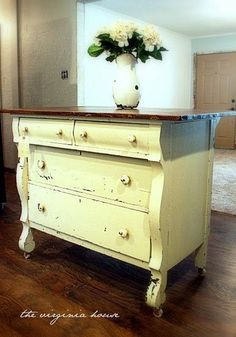 painted buffet to use as a kitchen island. Love the shape of this dresser!!
