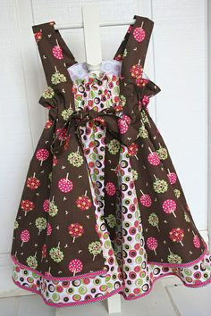 """BACK--Fall- Tree Feliz dress    Pattern is Feliz, which is now available in the book """"Sewing clothes Kids Love"""" by Landon and Pollehn(lovely book!). Fabric Finders mod twill dots #596, Tree print #928, and 1/16"""" chocolate checks"""