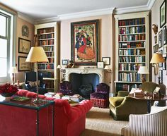 In this room by interior designer Charlotte Crossland french windows open onto a covered balcony. The George Smith sofa picks up the red notes in a Persian painting from Robert Kime and Farrow & Ball's 'Setting Plaster' on the walls.